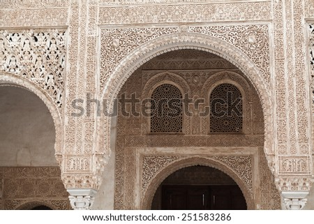 Polychromed stucco arch in the Alhambra of Granada, Spain - stock photo