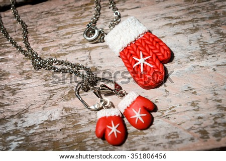 polymeric hand-worked clay jewelry . hristmas red gloves, snowman - stock photo