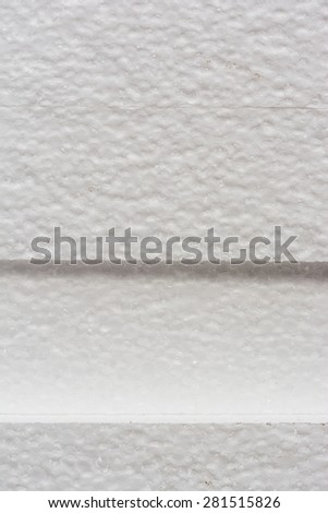 Polystyrene insulation boards background with copyspace, vertical side shot