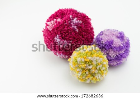Pom poms, fluffy, decorative ball made from wool - stock photo