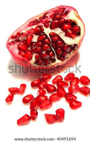 pomegranate and granules on white background - stock photo