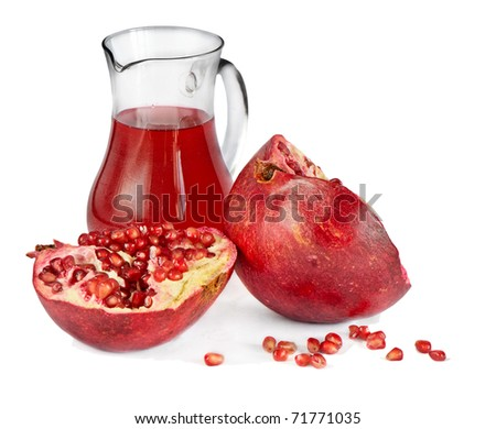 pomegranate and juice isolated in white