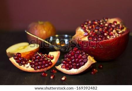 Pomegranate, apple and honey. Traditional jewish food. - stock photo