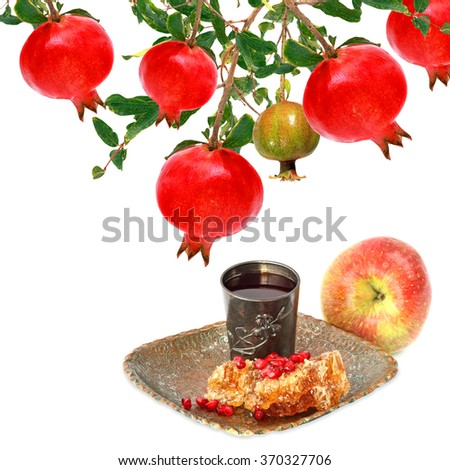 Pomegranate, apple fruit and honey comb with honey - Jewish traditional food for Rosh Hashana - Jewish new year