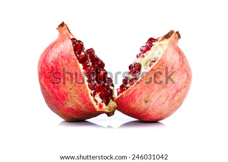 Pomegranate cut in halves over white background - stock photo