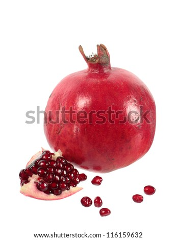 Pomegranate fruit and seeds isolated on white background
