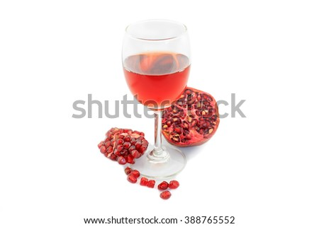 pomegranate juice in a glass on a white background
