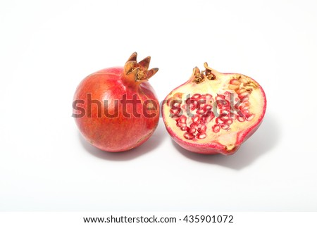 Pomegranate red fruit juicy ripe on white background