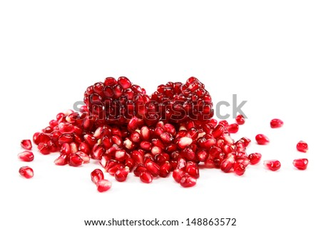 Pomegranate seeds on a white background. - stock photo