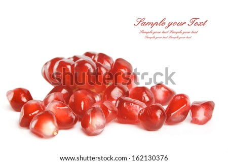 pomegranate seeds over white background