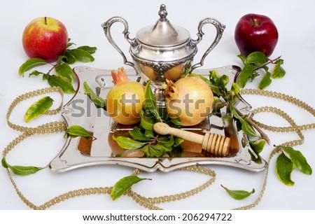 pomegranates and honey with apple for Rosh Hashana jewish new year - stock photo