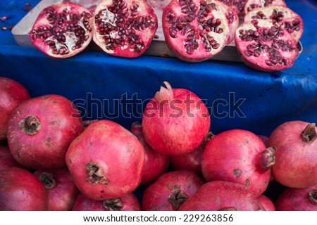 Pomegranates at the Market. Fresh farmer's market pomegranates. - stock photo