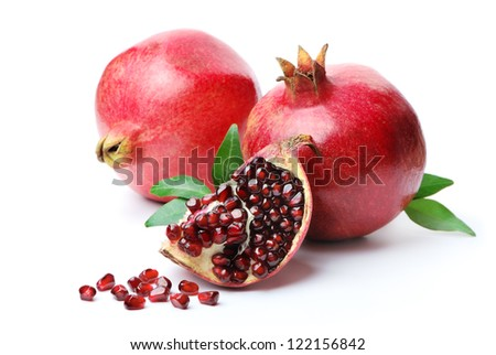 Pomegranates on a white background. Isolated. - stock photo