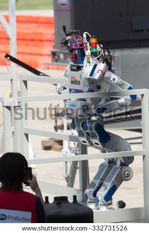 POMONA, CA - JUNE 6: Team KAIST's DRC-Hubo robot successfully completes stair climb task at the DARPA Robotics Challenge in Pomona, CA on June 6, 2015. The Korean robot went on to win the competition. - stock photo