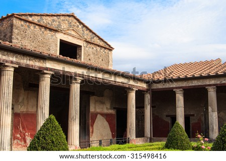 Pompeian villa in Pompeii, Italy. Pompeii is an ancient Roman city died from the eruption of Mount Vesuvius in the 1st century. - stock photo