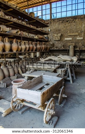 POMPEII, ITALY, JUNE 28, 2014: detail of a petrified corpse inside of area of ruins of the pompeii city. - stock photo