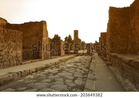 POMPEII, Italy - SEPTEMBER 30: Ruins on sunset on September 30, 2011 in Pompeii Italy.Tourists visiting the old roman town of Pompeii, destroyed by volcanic eruption of Mt Vesuvius - stock photo