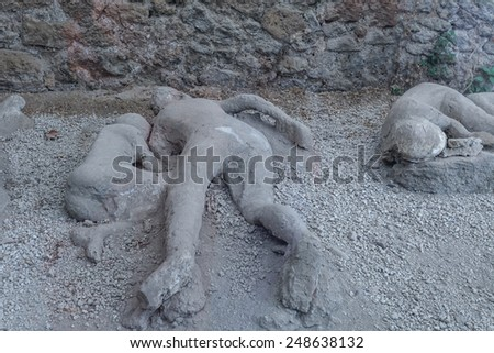 Pompeii reproduction of unearthed human figure that was buried in the ash - stock photo