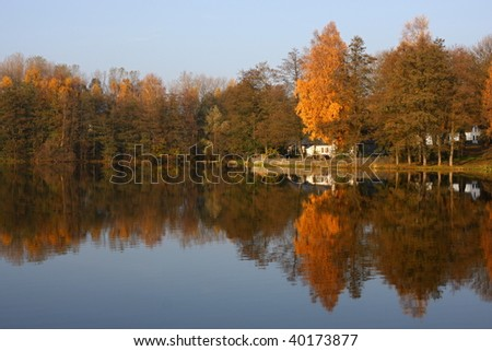 Pond and an old house in the autumn landscape, Czech Republic