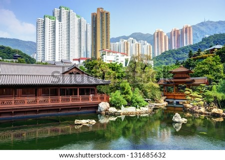 Pond and cityscape viewed from Nan Lian Garden in Hong Kong, China.
