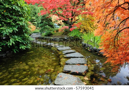 Pond and path of the japanese garden inside the famous historic butchart gardens (built in 1903), vancouver island, british columbia, canada - stock photo