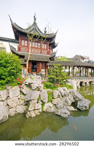 Pond and pavilion at Yu Yuan (The Garden of Peace and Comfort), Shanghai, China - stock photo