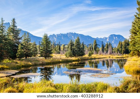 Pond in front of the Grand Teton Mountains.  On the Snake River near Oxbow Bend.  Jackson Hole, Wyoming, USA. - stock photo