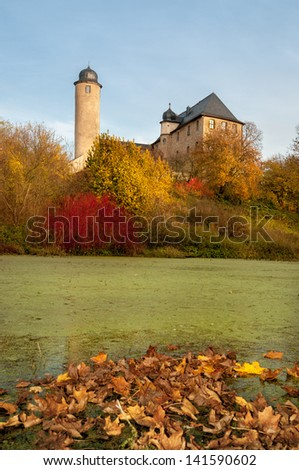 Pond with autumn leaves in rural Thuringia, Germany - stock photo