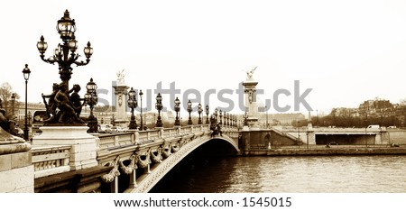Pont Alexandre III - Bridge in Paris, France.  Movement on cars driving – Gloomy winters day. Copy space, sepia tone - stock photo