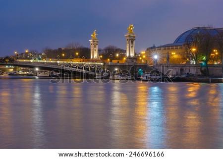 Pont Alexandre III or Alexander III bridge at night illumination in Paris, France - stock photo