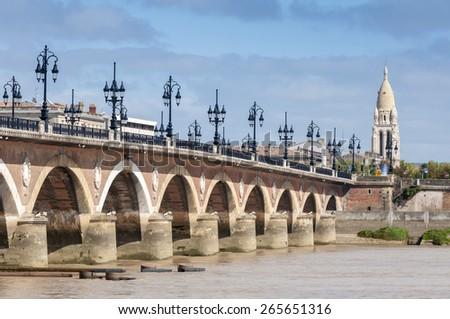 Pont De Pierre Bridge across Garonne River, Bordeaux (France) - stock photo