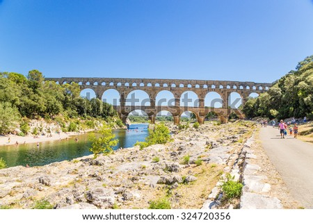 PONT DU GARD, FRANCE - JUL 21, 2015: The recreation area near the Pont du Gard, France, 1st century AD. Monument included in the UNESCO World Heritage List - stock photo
