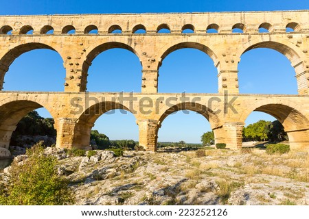 Pont du Gard is an old Roman aqueduct near Nimes in Southern France - stock photo