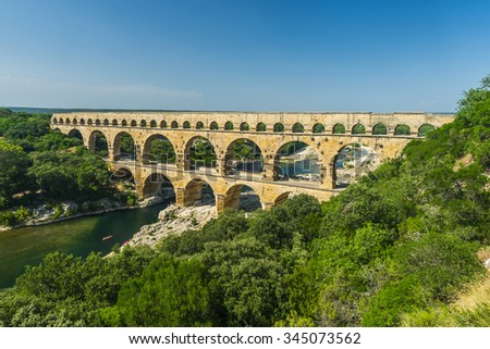 Pont du Gard is an old Roman aqueduct, southern France near Avignon - stock photo