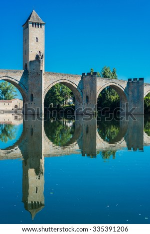 Pont Valentre, a 14th-century six-span fortified stone arch bridge crossing the Lot River to the west of Cahors in Lot, Midi-Pyrenees, France. - stock photo