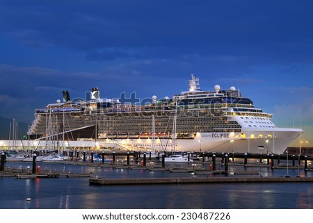 Ponta Delgada, Azores Islands, Portugal - September 24, 2014: Cruise Line Celebrity,  ship Eclipse docked at night in the port of Ponta Delgada city  in the Sao Miguel Island on September 24, 2014.  - stock photo