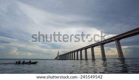 Ponte Rio Negro and boat, the middle of bridge over the Rio Negro with 3595 meters of length