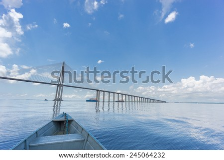 Ponte Rio Negro, the middle of bridge over the Rio Negro with 3595 meters of length that links the cities of Manaus and Iranduba - stock photo