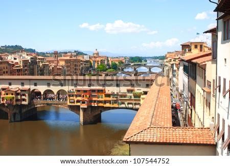 Ponte Vecchio and Corridoio Vasariano. View from window of the Galleria degli Uffizi - stock photo