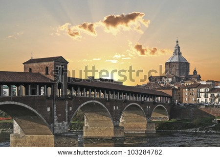 Ponte Vecchio bridge and the Dome in Pavia, Italy - stock photo