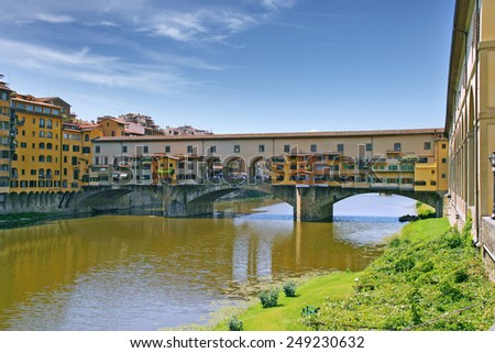 Ponte Vecchio is a famous medieval bridge over the River Arno in Florence, Italy - stock photo
