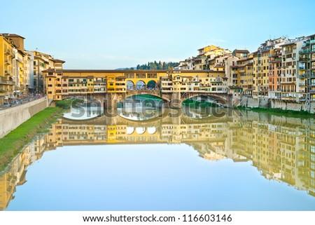 Ponte Vecchio, old bridge, medieval landmark on Arno river and its reflection. Long exposure photography. Florence, Tuscany, Italy. - stock photo