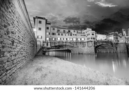 Ponte Vecchio over Arno River, Florence, Italy. Beautiful black and white view. - stock photo