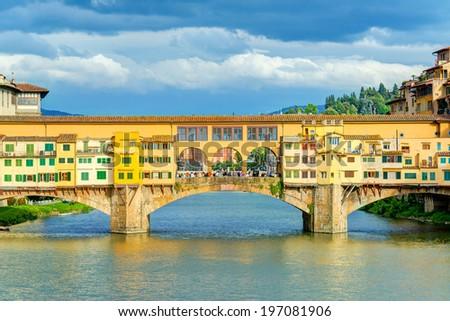 Ponte Vecchio over Arno river in Florence, Italy - stock photo