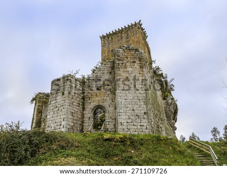 PONTEDEUME, SPAIN - MARCH 28, 2015: Facade of the Andrade's Tower, a defensive construction built on the top of a hill. - stock photo