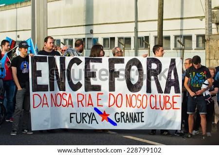 PONTEVEDRA, SPAIN - JUNE 21, 2014: Detail of ecological demonstration against the permanence of paper pulp industry in the Ria de Pontevedra. - stock photo