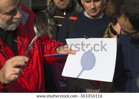 PONTEVEDRA, SPAIN - MARCH 20, 2015: People trying to see the almost total eclipse of the sun, which could be seen at that time in the city. - stock photo