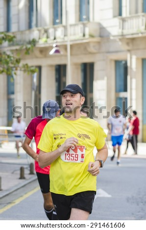Pontevedra, SPAIN - OCTOBER 19, 2014: Detail of participants in the popular race XVIII Ltd. Half Marathon 2014, held on the streets of the city.
