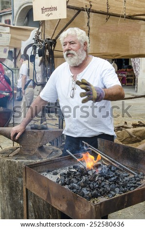 PONTEVEDRA, SPAIN - SEPTEMBER 6, 2014: A Forge with blacksmiths, in medieval festival held each year in the historical district of the city.