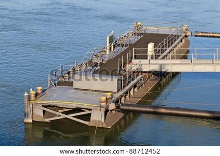 Pontoon Block / Bridge at harbor floating on water - stock photo